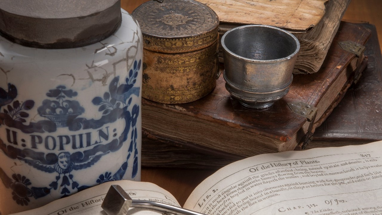 Antimony cup, apothecaries jar and medical text